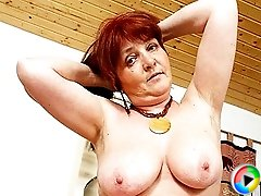 Redheaded granny gets lucky with a younger man