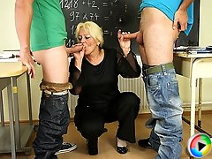 She punishes her misbehaving students and then a wild hardcore mature threesome erupts