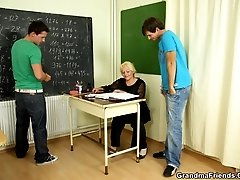 The mature teacher wants two dicks and the young men are up for the task of pounding her