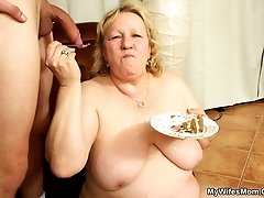 Birthday cake and cock are consumed in the gallery as granny takes her son in law's dick