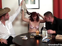 The redhead in black stockings is swallowing cock and getting fucked in her hot pussy